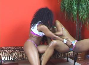 Two hot lesbians dark with a lolly